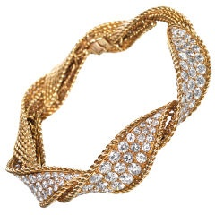 STUNNING!! Sterle Bracelet France Circa 1940 A pave diamond set twisted bangle mounted in 18ct yellow gold