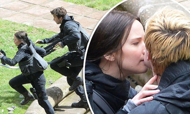 Jennifer Lawrence kisses Josh Hutcherson as they film Hunger Games