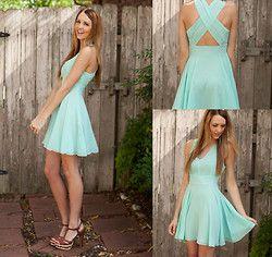Light teal. Pretty skirt. Crossed back.
