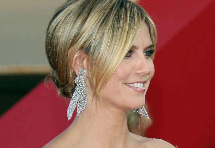 Heidi Klum opts for some oversized bow earrings during the Cannes Film Festival 2012