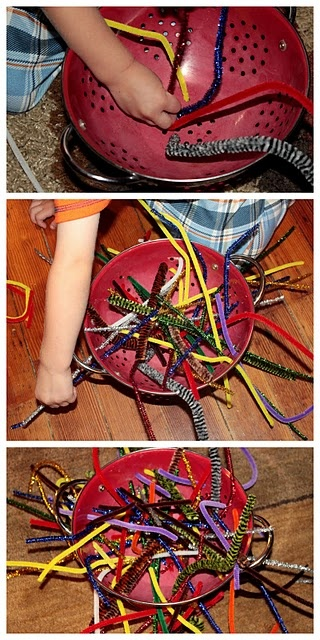 Fine Motor Skills - pipe cleaners through a colander