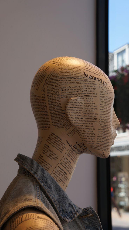 "Hennes&Mauritz, Utrecht, Holland,""Newspaper Headlines"", pinned by Ton van der Veer"