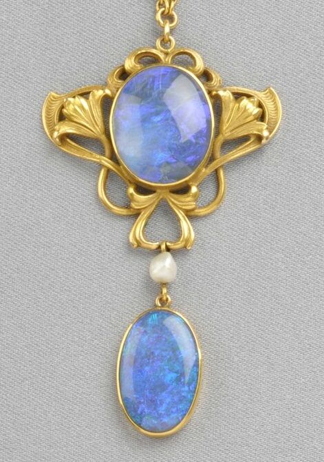 Art NOUVEAU__14kt Gold and Opal Pendant, Durand & Co., bezel-set with an opal cabochon within a scrolling mount with floral motifs, suspending a drop, and completed by fancy-link chain, the pendant lg. maker's mark. #opalsaustralia