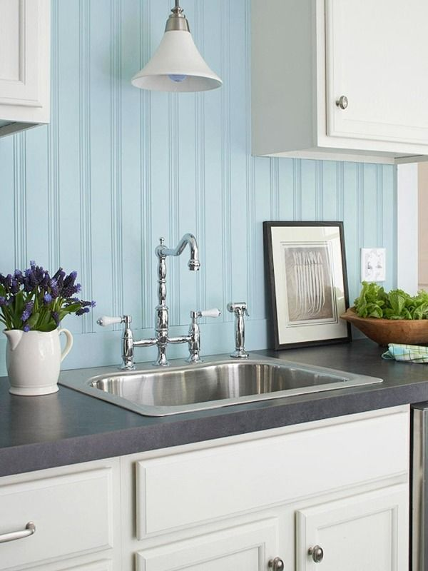 Light blue beadboard backsplash is ideal for a seaside kitchen. Pinned by #ChiRenovation - www.chirenovation.com
