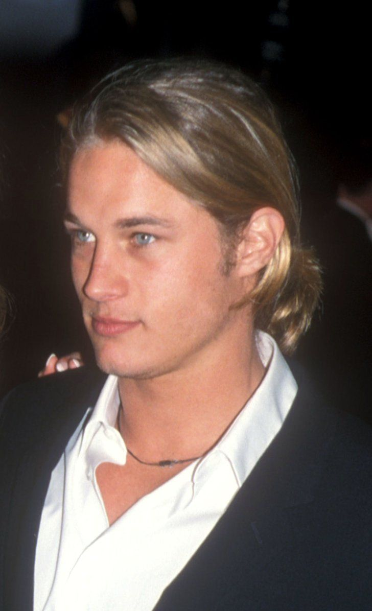 Pin for Later: If You Love Charlie Hunnam and Don't Know About Travis Fimmel, You're Missing Out Not all guys can rock a ponytail, but Travis Fimmel is definitely one of the lucky few.