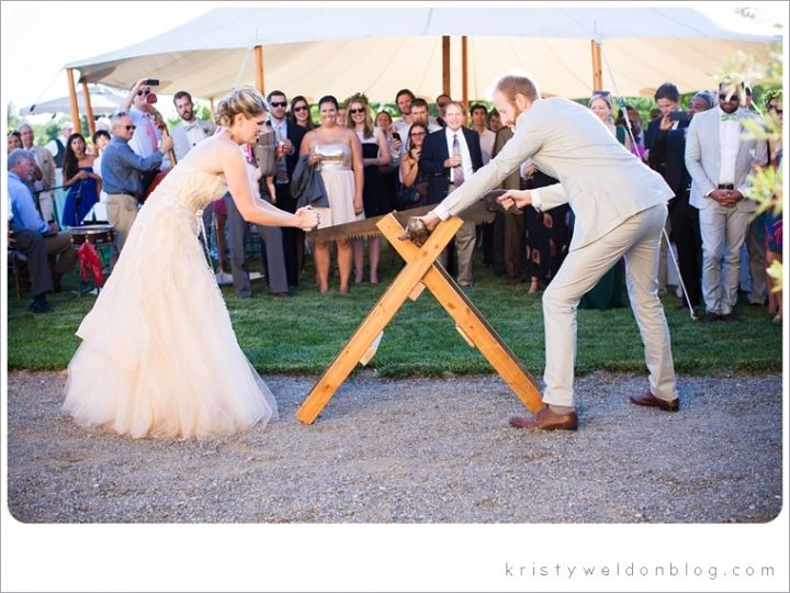 "An old German wedding custom, the tradition of cutting a log represents the first obstacle that the couple must overcome in their marriage. They must work together to ""overcome the obstacle"" by sawing through the log. Using a large, long saw with two handles, the couple demonstrates their teamwork to friends and family, and their willingness and ability to master the difficulties that inevitably arise in a marriage."
