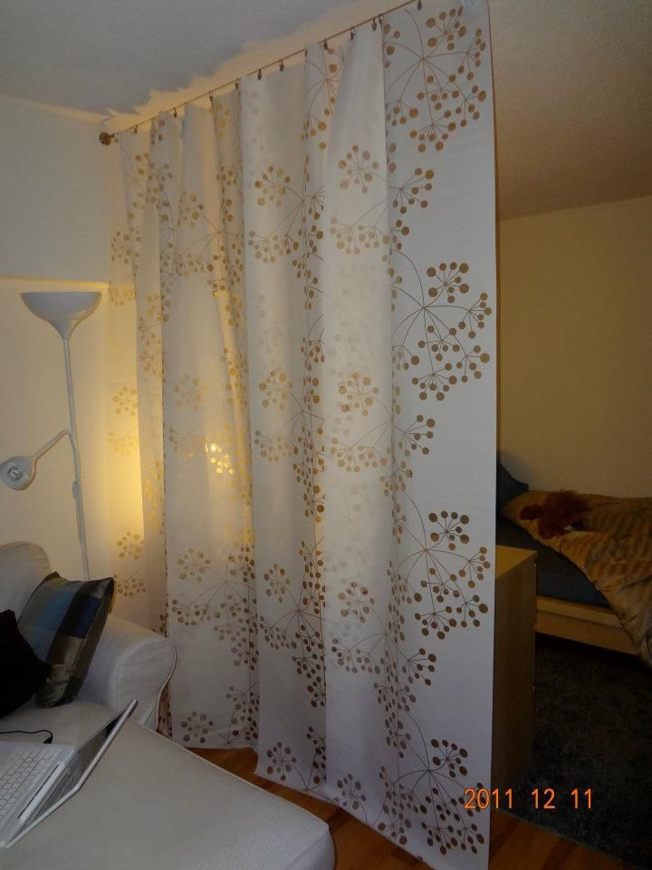 Ikea panel curtains hung on a wire curtain rod divider - Room divider curtain ideas ...