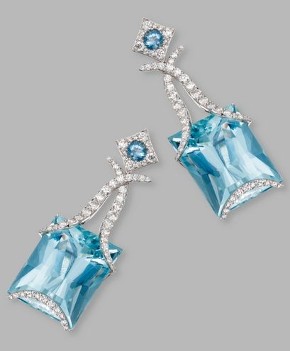 PAIR OF 18 KARAT WHITE GOLD, AQUAMARINE AND DIAMOND PENDANT-EARCLIPS, SAMUEL GETZ The pendants set with rectangular-shaped aquamarines weighing approximately 144.00 carats, suspended by round diamonds weighing approximately 6.00 carats, the tops accented by round aquamarines, signed Samuel Getz.