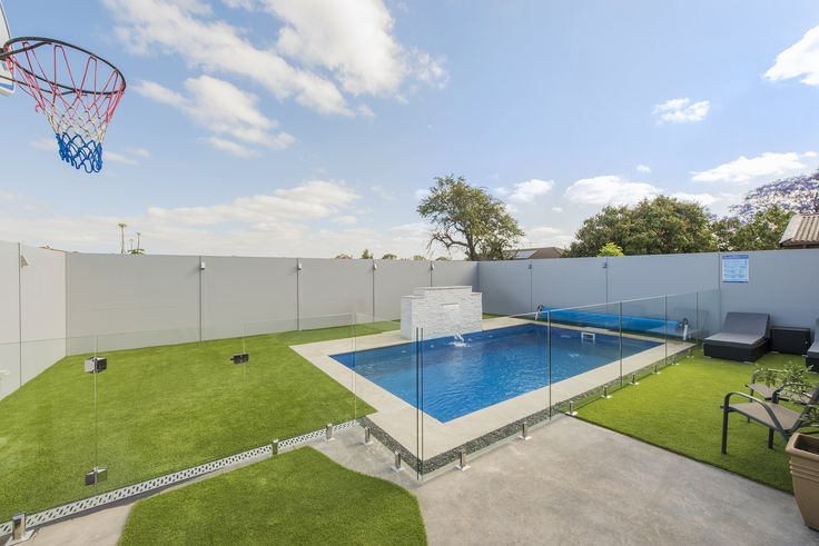 The owner of this home in the Sydney suburb of Concord wanted to build a tall boundary fence around the backyard swimming pool that would be aesthetically pleasing yet resilient.