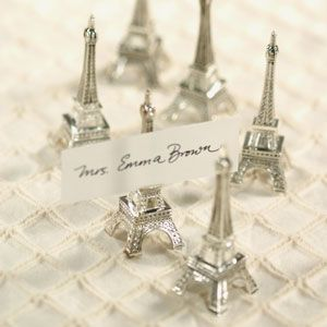 There are so many ideas for a wedding and a French Theme is one of them!  French Themed Wedding Favors - Eiffel Tower Place Card Holder.  Favor Couture The Aspen Shops http://www.favorcouture.theaspenshops.com