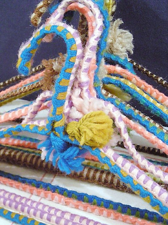 Yarn wrapped hangers. Made them in Campfire Girls