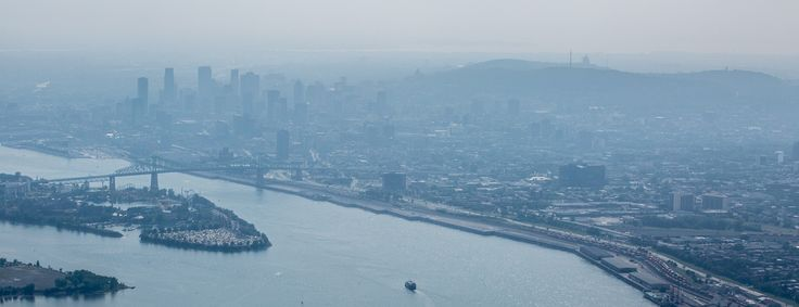 Hazy Montreal skyline as seen from an helicopter.