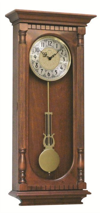 """Elegant flat top regulator style wall clock with an antique walnut finish. Full length reeded columns and dentil molding on door. Rich embossed metal dial with Arabic numerals. Decorative polished pendulum with harp. Dual-chime quartz that plays Westminster or Bim Bam with volume control, personalized night shut-off, quarter hour chime, full hour strike.  Measures: H 33-1/4"""" x W 15-3/4"""" x D 5-1/2"""" Three year manufacturer's warranty from http://www.theisenclock.com/wall_clock.html"""
