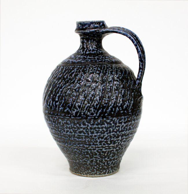 Mirek Smisek Stoneware jug, with strap handle, blue salt glaze, impressed potters cypher to the base. H. 280 mm