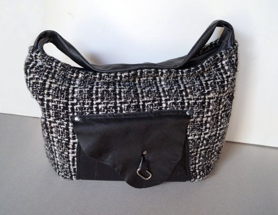 Unique, hand-sewn bag is made of black soft leather and decorative fabric with a touch of wool. A black pocket in irregular form is located in front of the bag, and inside ...