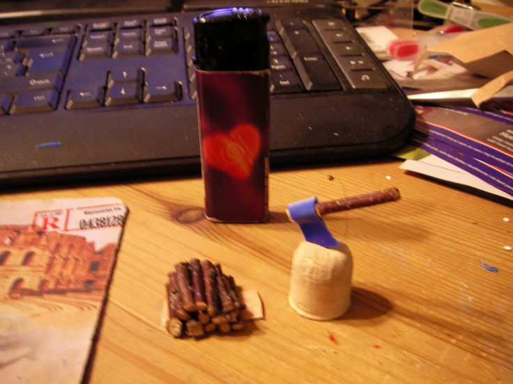 fairy  or elf axe and chopblock  made with a piece of plastic from a container glued to a stick, chopblock is a cork from a winebottle