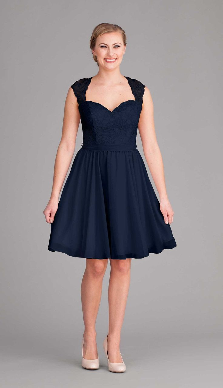 A short and sweet navy blue bridesmaid dress with a lace top and chiffon skirt.   Kennedy Blue Marissa