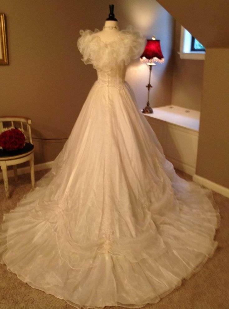 Here's the back of this gorgeous 1980s wedding dress!  Sold here: http://www.etsy.com/listing/96049714/reserved-for-rita-vintage1980s-ivory