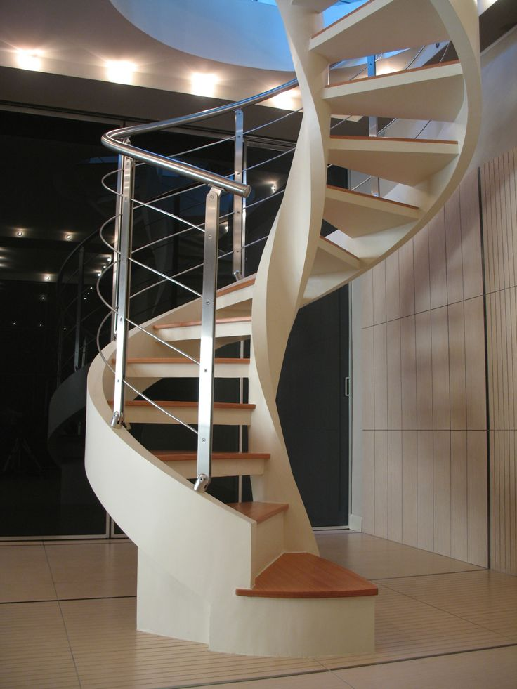 Concrete stair with railing by Rintal | Spiral staircase ...