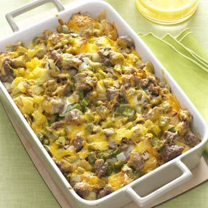 1 pound bulk pork sausage      1 large green pepper, chopped      1 medium onion, chopped      1 loaf (1 pound) herb or cheese bakery bread, cubed      1 cup (4 ounces) shredded cheddar cheese      6 eggs      2 cups 2% milk      1 teaspoon ground mustard