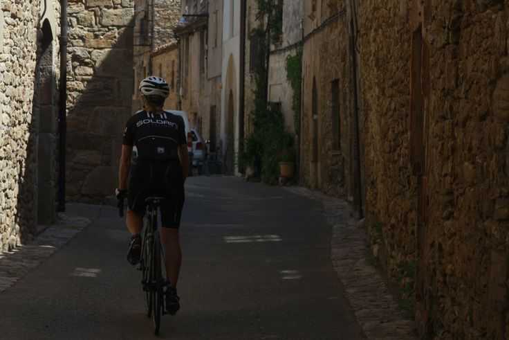 Cycling in the narrow streets of Girona, Catalonia Cycling