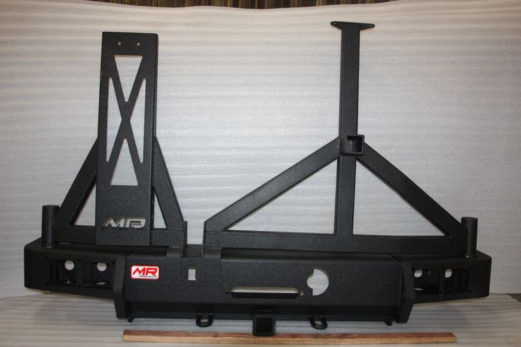 With this you will have all of the following: rear bumper, tire carrier, and fuel tank holder