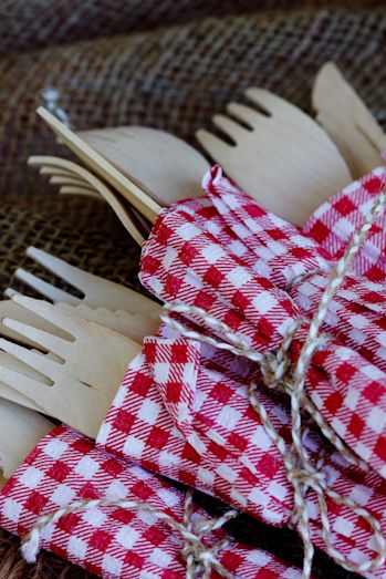 Bamboo cutlery wrapped in paper serviettes tied with twine for Braai (BBQ) table. (Photo: Alida Ryder - www.simply-delicious.co.za)