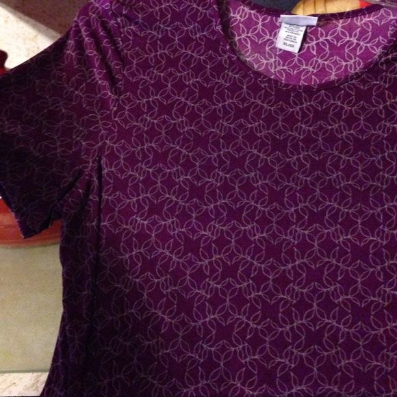 Purple shirt Purple short sleeve shirt, spandex and polyester made, very silky and comfortable Jaclyn Smith Tops