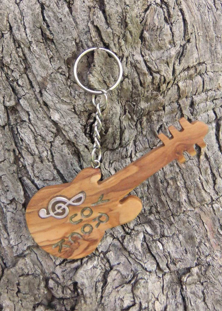 Hand carved Greek Olive Wood musical key chain guitar inlaid with Tibetan silver treble clef and engraved with rock and roll by ellenisworkshop on Etsy