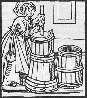 A dairy maid churning up some butter - Woodcut