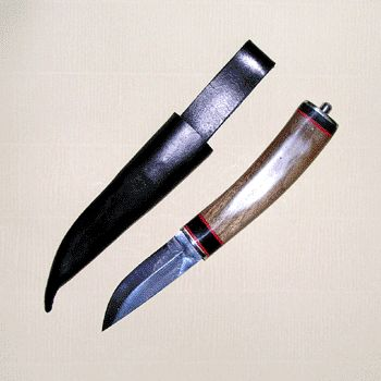 http://www.english-handmade-knives.co.uk/HowToMake-A-Handle.html