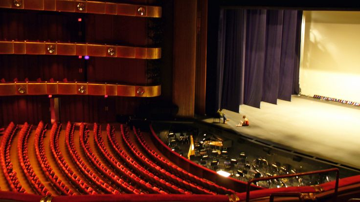 The lone dancer on stage receiving corrections on stage at the David H Koch theater