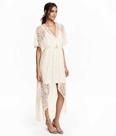 V-neck dress in lace with short butterfly sleeves. Short at front and full-length at back. Attached liner dress in soft jersey with narrow, adjustable shoulder straps.