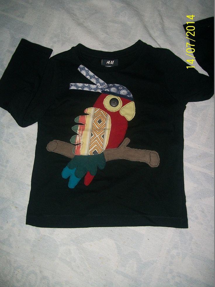 Restjes stofkes worden papegaai-applicatie voor meisjes T-shirt