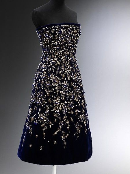 'Bosphore' (Bosphorus); La Ligne Aimant (Magnet)        Object:        Evening dress      Place of origin:        Paris, France (made)      Date:        1956 (made)      Artist/Maker:        Dior, born 1905 - died 1957 (designer)      Rébé (embroiderer)      Materials and Techniques:        Embroidered velvet with gold thread, sequins, pearls and pastes, and net, silk and boned      Credit Line:        Given by Mr Stavros Niarchos III