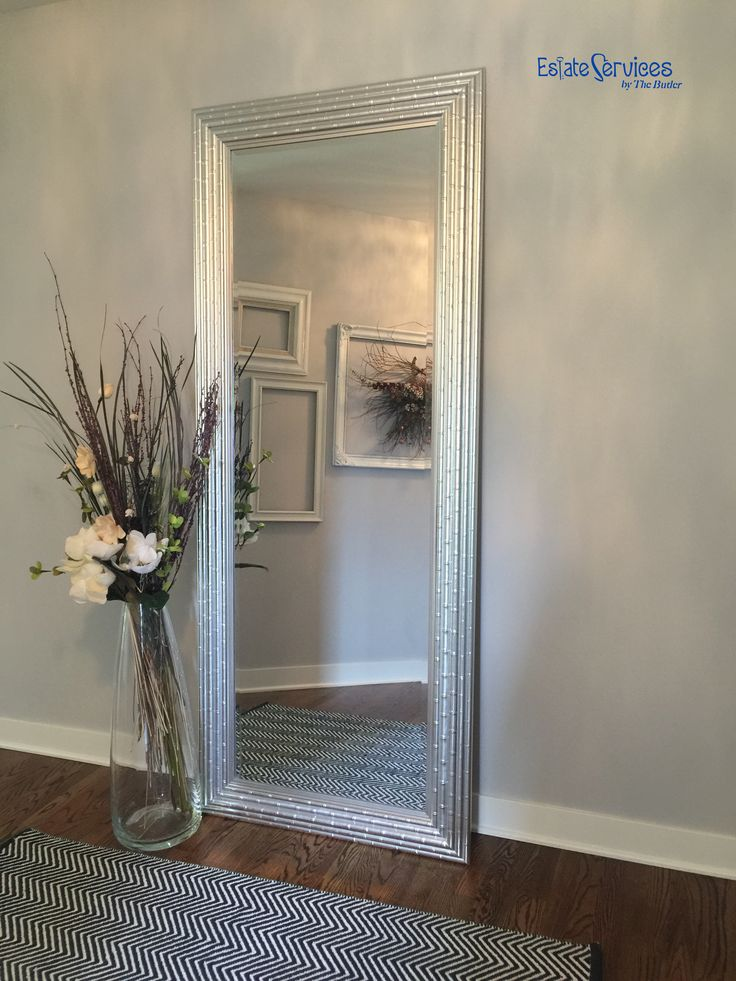 Simple Floor Accessory! Tall Mirror for an illusion for added space. Decorative clear vase and flowers for a finished look.