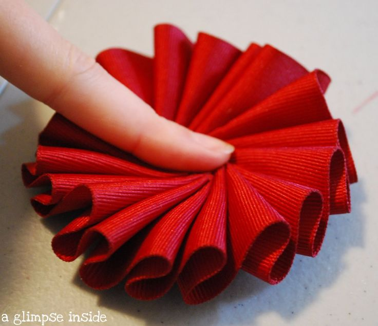 I first showed you this wreath when I shared my living room Christmas decorations.  I needed to make something for the center shutter and I...