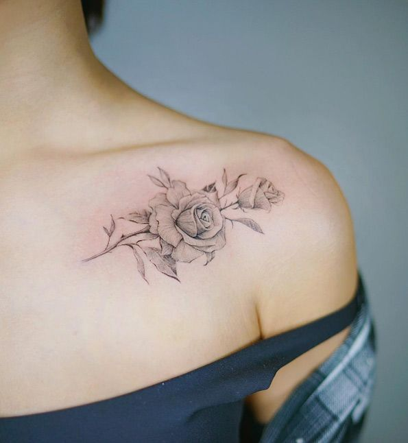 Elegant rose tattoo on shoulder by Nando