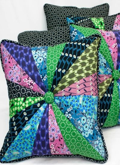 Use your leftover scraps of fabric to create these unique Homestead Pinwheel Button Pillows!