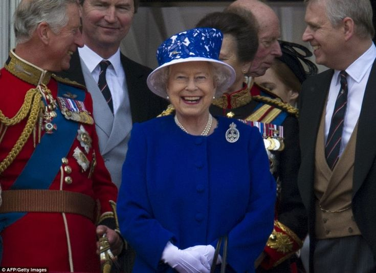 Enjoying herself! The Queen is all smiles as she joins Prince Charles, and Prince Andrew ahead of the fly-past on the balcony at Buckingham Palace, June  2013