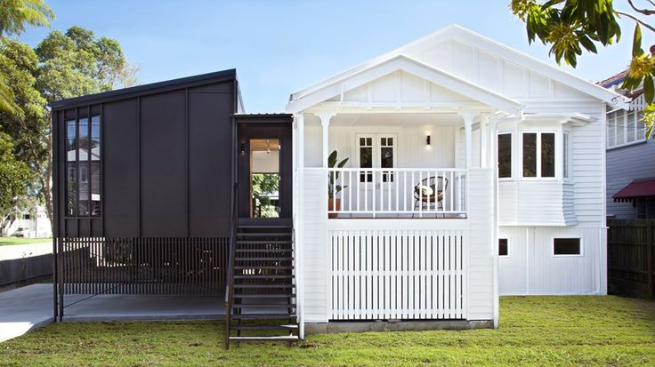 old queenslander with new charcoal extension - contrast is lovely but the timber still has the same relationship