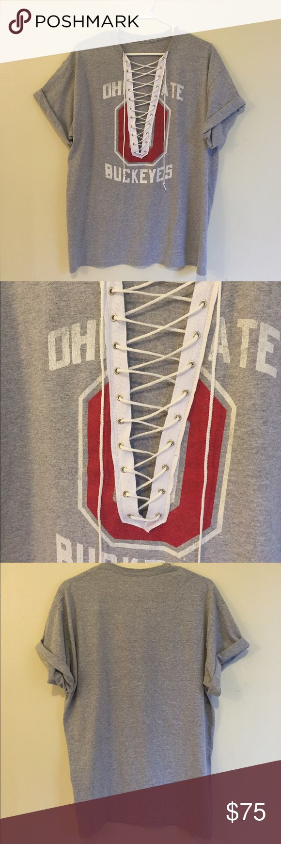 Ohio State Buckeyes Lace Up Tee Ohio State Buckeyes Lace Up Graphic Tee  Handmade ✨  Size: large (meant to fit oversized)  Check out the rest of my designs on I G:@cherrybombxvintage  Custom orders welcome! Brandy Melville Tops Tees - Short Sleeve