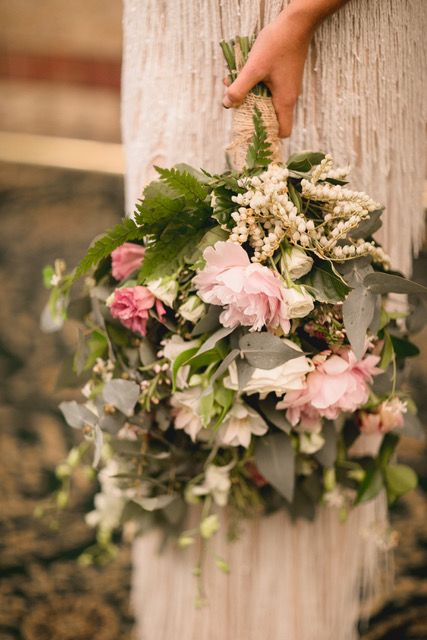 Trial rustic style bouquet, peonies, gum and lisianthus.