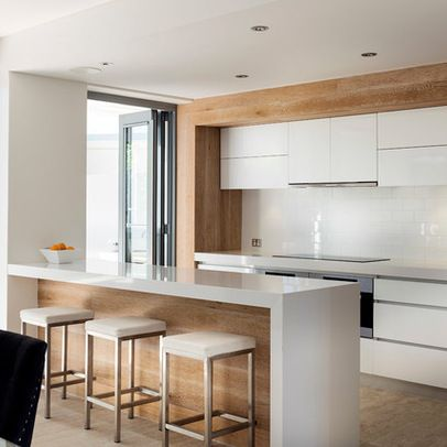 I do like this simple streamlined kitchen with timber element