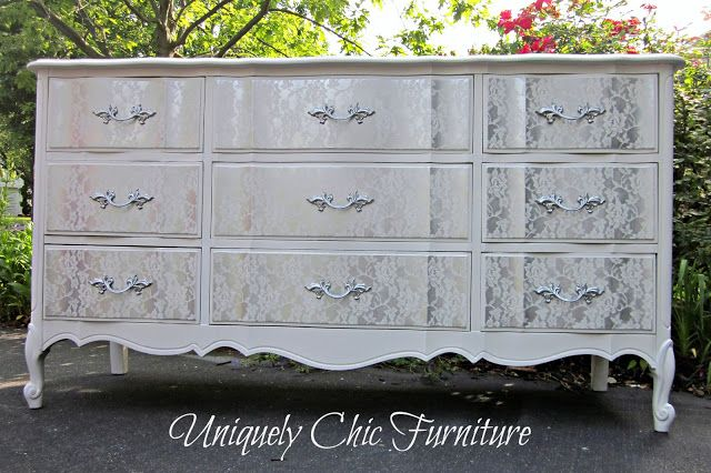Laying lace over a drawer front as a stencil, then spray-painting over it to create this look.  Beautiful and sophisticated.  Just use a new piece of lace for every drawer.