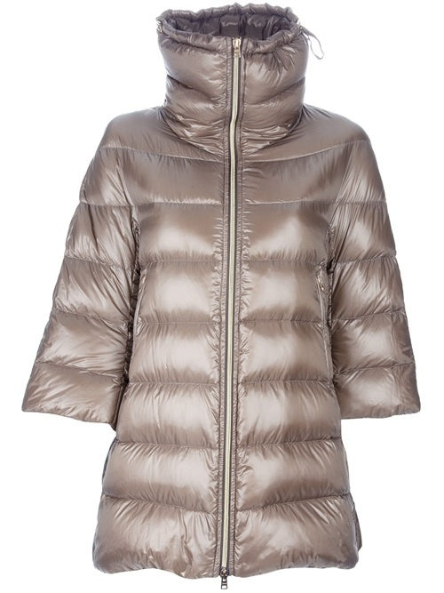 Gold-tone padded coat from Herno featuring a large funnel neck, a central front zip fastening, two side zip pockets, three-quarter length sleeves, and a curved rear hem.