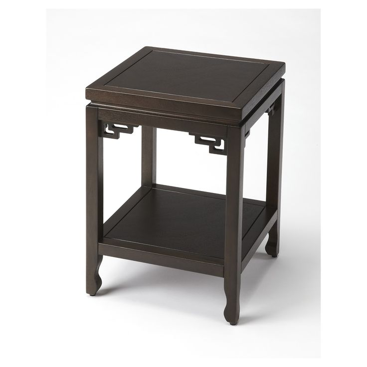The Xingfu Contemporary End Table from Butler Specialty lends stylish and exotic flair to any space. Made from a deep espresso hardwood, this contemporary end table features a fixed shelf below the tabletop as well as decorative scrollwork along the table legs. Geometric cutouts add a pop of distinction to this contemporary end table, making it a true statement piece wherever it goes.