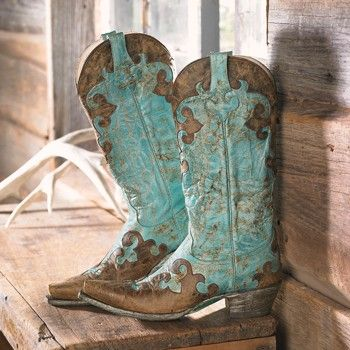 Turquoise and Brown Cowboy Boots.  Cool.                                                                                                                                                      More