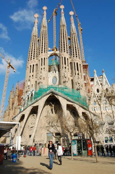 The largest and most recognizable of Antoni Gaudi's buildings is the Sagrada Familia, his unfinished masterpiece. Gaudi began work on the massive church in 1882 and worked on it until his death, 40 years later. Four of the towers have been completed, while work on the additional fourteen called for in Gaudi's plan is ongoing.