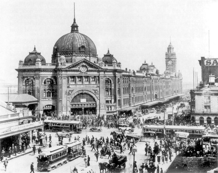 Intersection of Swanston and Flinders Streets showing electric and cable trams, 1927